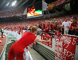 Athens, Greece - Wednesday, May 23, 2007: Liverpool's John Arne Riise throws his shirt to the fans after losing 2-1 to AC Milan during the UEFA Champions League Final at the OACA Spyro Louis Olympic Stadium. (Pic by David Rawcliffe/Propaganda)