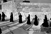 Orthodox nuns make their way from Bethany to Jerusalem on Palm Sunday. Israel. Bethany was the site of a miracle in which Jesus raises Lazarus from the dead.