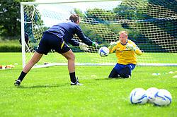 Bristol Rovers' goalkeeper, Steve Mildenhall is being coached from goalkeeping coach Stuart Naylor  - Photo mandatory by-line: Dougie Allward/JMP - Tel: Mobile: 07966 386802 24/06/2013 - SPORT - FOOTBALL - Bristol -  Bristol Rovers - Pre Season Training - Npower League Two