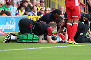 Scunthorpe United defender Cameron Borthwick-Jackson (3) receiving medical attention during the EFL Sky Bet League 1 match between AFC Wimbledon and Scunthorpe United at the Cherry Red Records Stadium, Kingston, England on 15 September 2018.