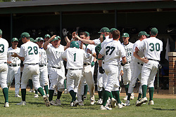 22 April 2006:  ....Titan Pinch Runner Mike Ally gets a fond beating after scoring the 2nd Titan run.....In CCIW, Division 3 action, the Titans of Illinois Wesleyan capped the Auggies of Augustana College by a scor of 3-2 in game one of a double card afternoon.  Games were held at Jack Horenberger field on the campus of Illinois Wesleyan University in Bloomington, Illinois