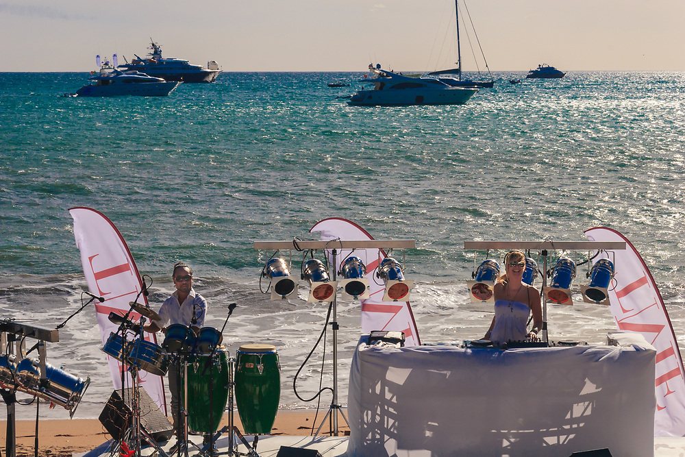 Music performance on Cannes beaches in France. French Riviera life includes sea, sun, music and yachts.