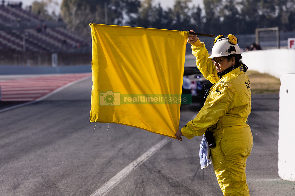 February 18, 2019 - Barcelona, Barcelona, Spain - Marshal with the yellow flag during the Formula 1 2019 Pre-Season Tests at Circuit de Barcelona - Catalunya in Montmelo, Spain on February 18, 2019. (Credit Image: © Xavier Bonilla/NurPhoto via ZUMA Press)