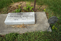 31 August 2017:   Veterans graves in Cheneys Grove Township Cemetery in eastern McLean County.<br /> <br /> In autumn of 1862 a Union Soldier known to know one locally and carrying no personal identification or papers appeared at the home of Dr. James Ballard in Saybrook Illinois.  He was delirious from fever and soon fell unconscious.  He never regained consciousness and died just a few days later.  With no one to notify, he was buried in Cheney's Grove Township Cemetery on the towns west side.