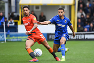 Wycombe Wanderers Forward Nathan Tyson (23) and AFC Wimbledon Defender Tennai Watson (2) in action during the EFL Sky Bet League 1 match between AFC Wimbledon and Wycombe Wanderers at the Cherry Red Records Stadium, Kingston, England on 27 April 2019.