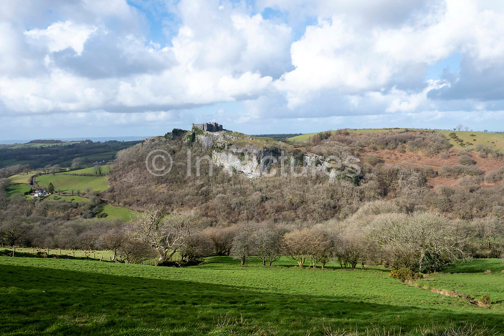 South wall of Carreg Cennen Castle positioned on the top of limestone cliff precipice on 18th February 2019 in Trapp, Powys, Wales, United Kingdom. The castle has been in a ruinous state since 1462 and is under the care of Cadw, the Welsh Government historic environment service, however the estate is used as working farm land.