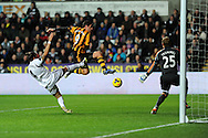 Hull's Danny Graham shoots and scores his sides 1st goal. Barclays Premier league, Swansea city v Hull city at the Liberty Stadium in Swansea, South Wales on Monday 9th Dec 2013. pic by Andrew Orchard, Andrew Orchard sports photography.