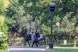 "© Licensed to London News Pictures. 15/09/2020. London, UK. Mounted Police patrol Hyde Park enforcing the ""Rule of Six"" as sunbathers enjoy the warm sunshine this morning as the mini-heatwave continues in the South East of England with highs of 29c. Prime Minister Boris Johnson announced last week that gatherings of more than six people will be banned from Monday (yesterday) in the hope of reducing the coronavirus R number. The Rule of Six has already become unpopular with MPs and large families for being too strict. Photo credit: Alex Lentati/LNP"
