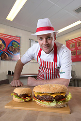 EDITORIAL USE ONLY<br /> Butcher Shaun Speight prepares the 'Daddy of all Burgers', made with a full pound of 100\% British beef at Morrisons in Harrogate, West Yorkshire, which will be on sale for &pound;3 at the supermarkets nationwide in the run up to Father's Day.