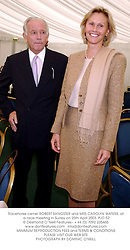 Racehorse owner ROBERT SANGSTER and MRS CAROLYN WATERS, at a race meeting in Surrey on 25th April 2003.PJD 52