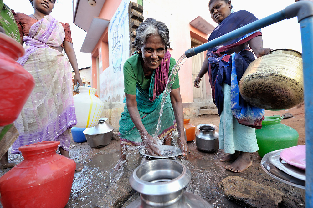 Women get water at a well in Nallur, a small village in the state of Tamil Nadu in southern India.