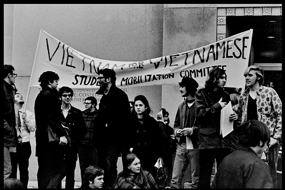 Madison, WI – May, 1970. Members of the Student Mobilization Committee on campus. On May 1, 1970, there was a general student strike in response to the news that the U.S. had expanded bombing into Cambodia. There was a march against the war, led by Veterans for Peace in Vietnam; and after the May 4 shootings at Kent State University in Ohio, there were more protests at UW Madison, which led to the police being called in, and teargassing demonstrators in the streets and on campus.