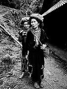 Mother with daughter following behind