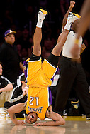 The Lakers' Shannon Brown rolls over after drawing a foul on the Clippers' Chris Kaman and scoring the basket during the Lakers' 108-95 victory at Staples Center Friday February 25, 2011.