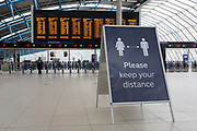 With the UK's Coronavirus pandemic lockdown easing with preparations going ahead for the opening of more public transport and services plus shops, another 151 have died from Covid-19 bringing the total in the last 24hrs to 41,279. Signs advise rail passengers who will be making their way soon through the concourse Waterloo Station, to keep their distance, while being asked to wear face coverings and to stay apart which is in line with government requirements for all users of public trransport starting next Monday (15th June), on 11th June 2020, in London, England.