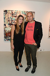 BILLY ZANE and RACHELLE LUNNON Director & Curator of the Rook & Raven Gallery at a private view of an exhibition of paintings by Billy Zane entitled 'Save The Day Bed' held at the Rook & Raven Gallery, Rathbone Place, London on 10th October 2013.
