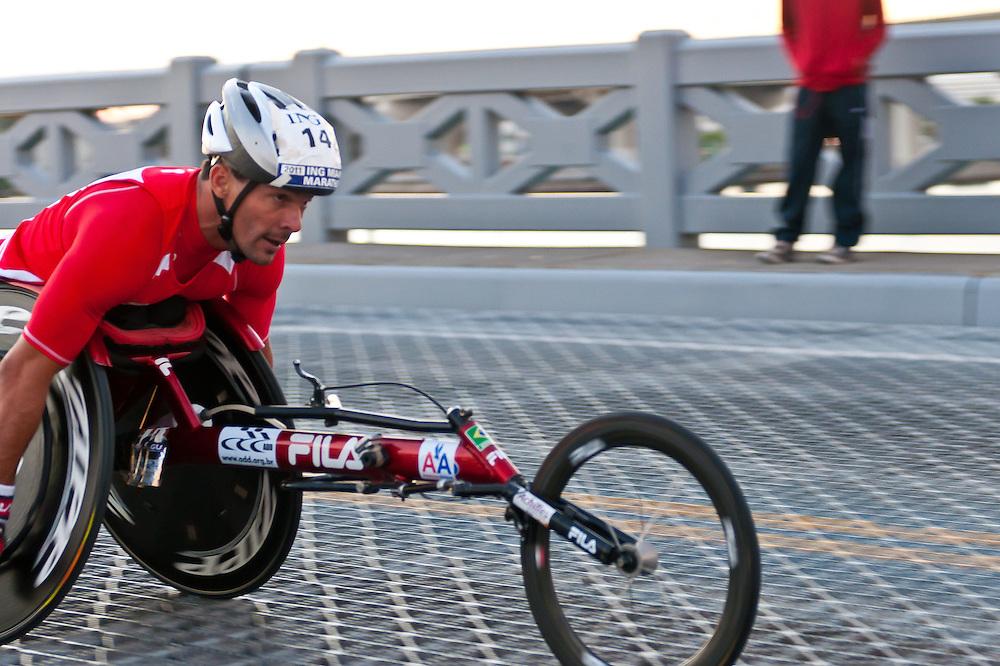 MIAMI, FL - JANUARY 30: Competitor racing in  wheelchair during the Miami Marathon. January 30, 2011 in Miami, Florida.