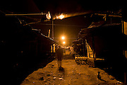 KENYA. Nairobi. Image of the main market place in the slum of Kibera by night...Kibera is Africa's largest slum and it is located in Nairobi, Kenya. It houses one million people squeezed into less than a square mile.