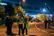 Police at the Scene in Broxbourne as Extinction Rebellion environmental activist group maintain the blockade throughout the night using vehicles and bamboo lock-ons to try to prevent the Sun, Times, Telegraph and Mail newspapers from reaching newsstands on Saturday, Sept 5, 2020. The action took place in Broxbourne in Hertfordshire (in the picture) and Knowsley in Liverpool. Extinction Rebellion (XR) said about 80 activists were involved. Environmental nonviolent activists group Extinction Rebellion enters its 5th day of continuous ten days protests to disrupt political institutions throughout peaceful actions swarming central London into a standoff, demanding that central government obeys and delivers Climate Emergency bill. (VXP Photo/ Vudi Xhymshiti)