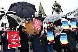 © Licensed to London News Pictures. 20/12/2019. London, UK. Brexit supporters celebrate outside Parliament after MPs voted to pass the Withdrawal Agreement Bill. Photo credit: Rob Pinney/LNP