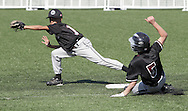Chester, New York - A baserunner slides into second base as an infieldercatches the throw during the TRUMP March Madness youth baseball tournament at The Rock Sports Park on March 17, 2012.