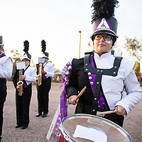 Renee Horsley, 17, plays the snare drum for the Miyamura Patriots High School Band as they warm up Friday night before their homecoming game against Gallup High School at Angelo Dipaolo Memorial Stadium in Gallup.