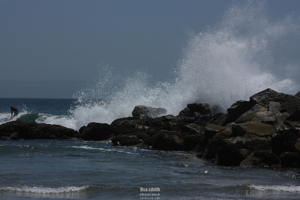 Scenes from Venice and Santa Monica California.  Beach, skateboarders, surfers,Santa Monica pier, amusement rides.