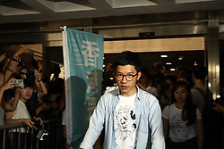 August 17, 2017 - Hong Kong, CHINA - Chairman of the Localist political party DEMOSISTO and disqualified lawmaker, Nathan Law exit from the High Court to meet the medias. Hong Kong pro-democracy activists, Joshua Wong, Nathan Law and Alex Chow are sentenced 6 to 8 years in jail after High Court announced their verdict today. Aug 17, 2017.Hong Kong.ZUMA/Liau Chung Ren (Credit Image: © Liau Chung Ren via ZUMA Wire)