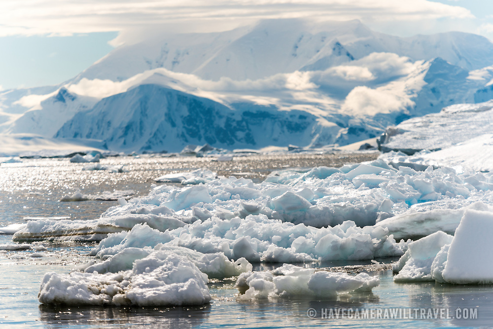 Small icebergs and brash ice on the waterfront of Neko Harbour in Antarctica.