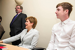 Pictured: Company Net Chief Executive Andy Hamilton ensures First Minister Nicola Sturgeon does not distract student Adam Fisher <br /> <br /> Ahead of the Programme for Government, First Minister Nicola Sturgeon visited  IT company  Digital Net in Edinburgh.  DIgital Net use innovative digital training to upskill their young workforce. During the visit, Ms Sturgeon met modern apprentices taking part in a digital skills lesson in their dedicated digital skills classroom.<br /> <br /> Ger Harley: 5 September 2017