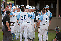 Laconia  Muskrat Regan Flaherty is congratulated by his teammates after bringing in three runs during playoff game 2 versus the Newport Gulls Thursday evening at Robbie Mills Field.   (Karen Bobotas/for the Laconia Daily Sun)