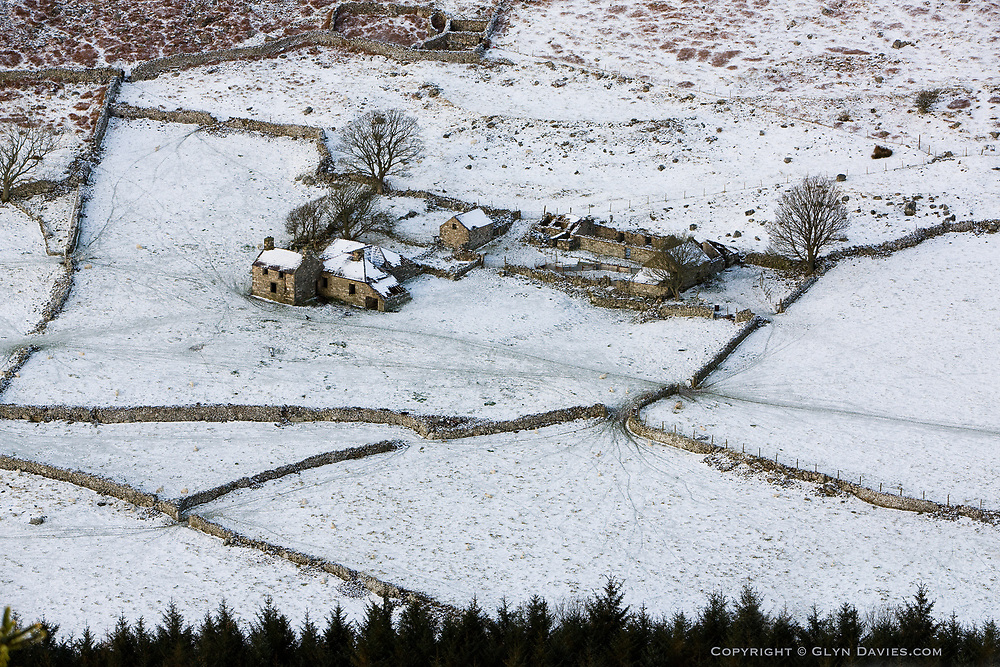 From above, and in the natural serenity of recent snow, Tŷ Uchaf farmhouse looks beautiful, normal and inhabited, no longer the empty shell for sheep droppings, birds of prey and an occasional dead lamb. At one point in time I can imagine this farm could have been a very striking place to live and work, with stunning views, but the isolation, loneliness and hardship of tending livestock in this difficult valley, and getting them to market, could also have been just seriously hard work!