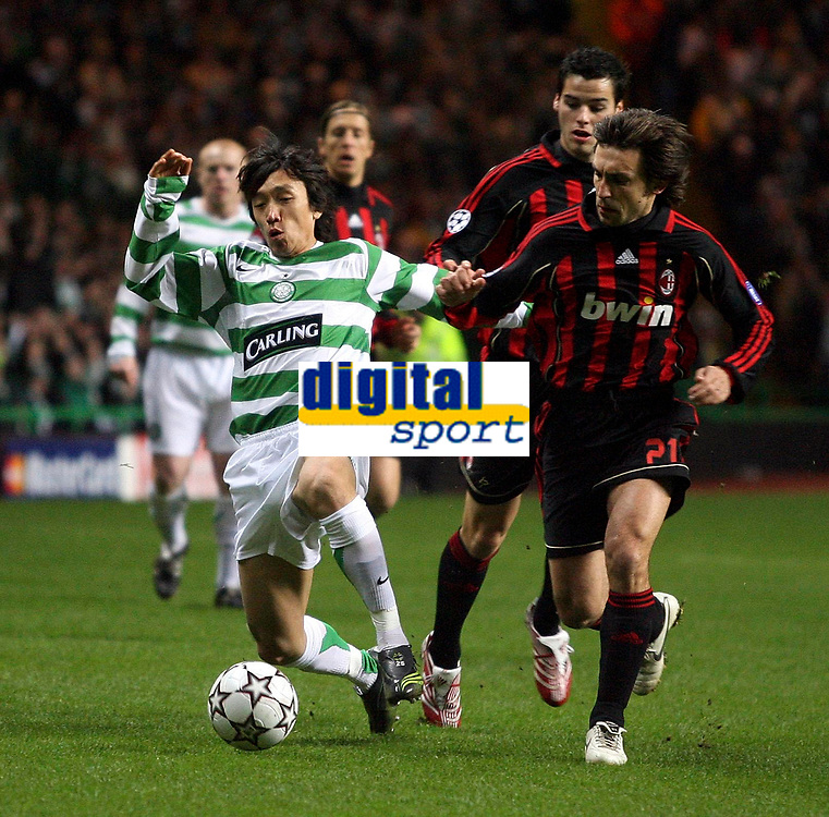 Photo: Paul Thomas.<br /> Glasgow Celtic v AC Milan. UEFA Champions League. Last 16, 1st Leg. 20/02/2007.<br /> <br /> Shunsuke Nakamura (L) of Celtic tries to evade Andrea Pirlo.
