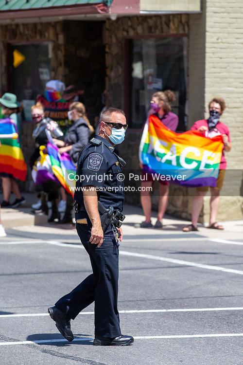 Mifflinburg Police Chief Jeffrey Hackenburg crosses Chestnut Street during the Mifflinburg Pride Event.