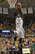WICHITA, KS - NOVEMBER 14:  Forward Nick Wiggins #15 of the Wichita State Shockers drives to the basket for a dunk against the William & Mary Tribe during the first half on November 14, 2013 at Charles Koch Arena in Wichita, Kansas.  (Photo by Peter G. Aiken/Getty Images) *** Local Caption *** Nick Wiggins