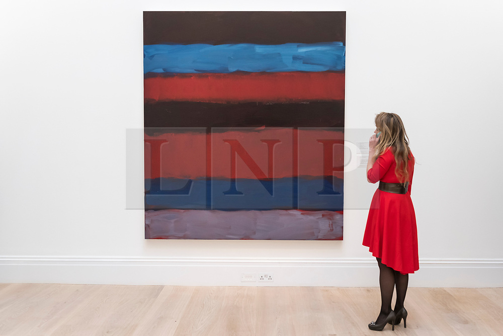 "© Licensed to London News Pictures. 01/03/2019. LONDON, UK. A visitor views ""Landline Red Blue"", 2015, by Sean Scully, (Est. £700,000 - 1,000,000).  Preview of Sotheby's Contemporary Art Sale in their New Bond Street galleries.  Works by artists including Tracey Emin, Jenny Saville, Jean-Michel Basquiat and Andy Warhol will be offered for auction on 5 March 2019.  Photo credit: Stephen Chung/LNP"