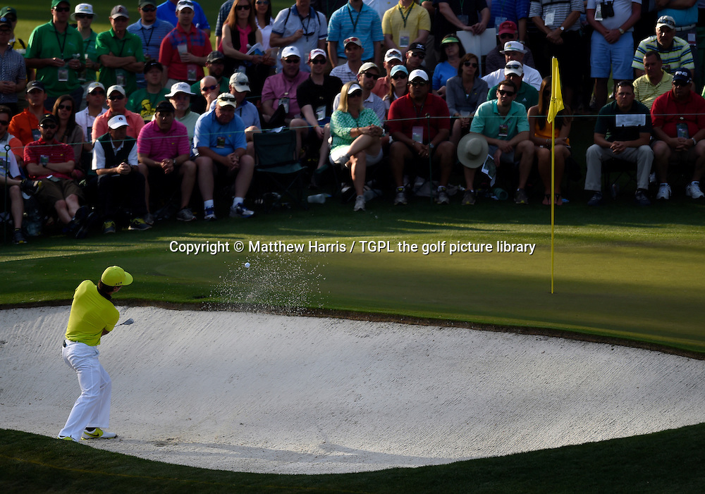 Thorbjorn OLESEN (DEN) plays from bunker at 16th par 3 during second round US Masters 2014,Augusta National,Augusta, Georgia,USA.