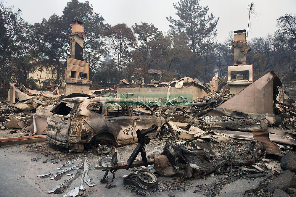 October 11, 2017 - Napa, California, U.S. - This home, like many others in the Silverado Country Club area was destroyed by a raging Atlas fire fed by wind on Monday. Residents are anxious to return to their home but the conditions are still too dangerous. More than 50,000 acres have burned in Napa and Sonoma counties. (Credit Image: © Randy Pench/Sacramento Bee via ZUMA Wire)
