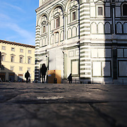 FLORENCE, ITALY - OCTOBER 31: <br /> Early morning commuters passing the exterior of Florence's Cathedral, Basilica di Santa Maria del Fiore, known as Duomo in Florence, Italy. The Duomo is the main church of the city of Florence. Construction was started in 1296 in the Gothic style with the structure completed in 1436. The famous dome was designed by Arnolfo di Cambio and engineered by Filippo Brunelleschi. Florence, Italy, 31st October 2017. Photo by Tim Clayton/Corbis via Getty Images)