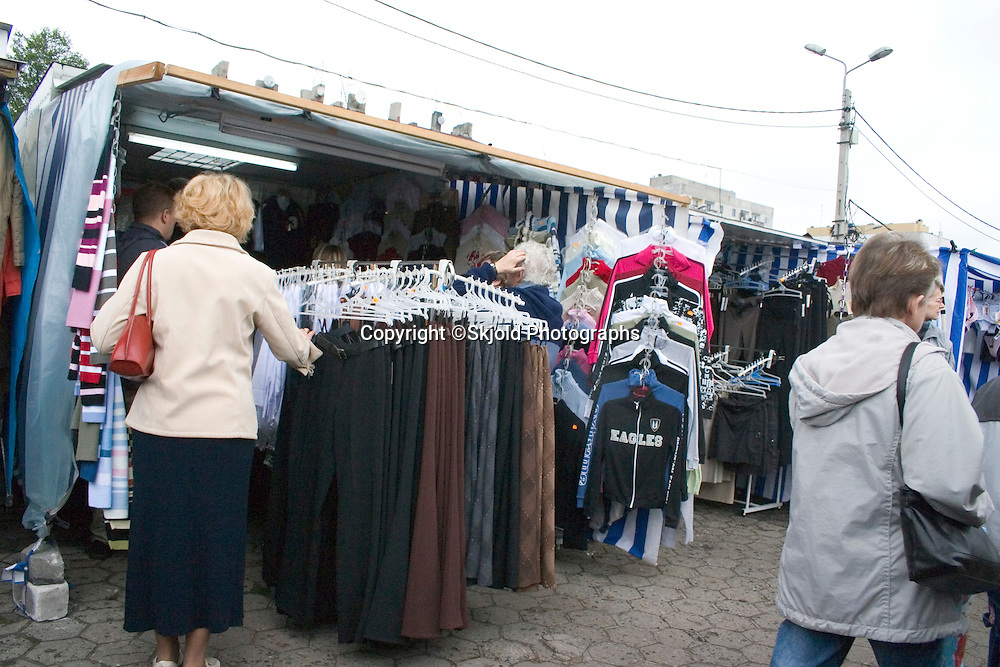 Shopper looking at clothes at the Balucki Rynek market.  Lodz   Central Poland