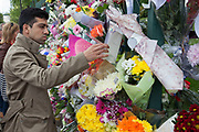 London, UK. Saturday 25th May 2013. Shoaib Zefar (25) from Pakistan, at the memorial to Drummer Lee Rigby in Woolwich, London, UK. He says that what happened here is not Islam, but that all Islam was peaceful and how important it was fro them to come to pay their respects. Flowers from every section of the local community along with messages of condolence and support. On the afternoon of 22 May 2013, Lee Rigby, a British Army soldier and a Drummer of the Royal Regiment of Fusiliers, was killed by two attackers near the Royal Artillery Barracks in Woolwich, south-east London.