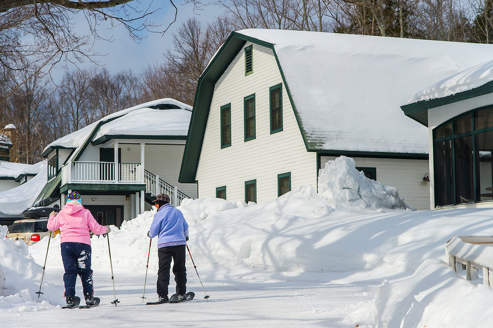 Participants in the Michigan DNR Becoming an Outdoors Woman program try out backcountry skiing at Bay Cliff Health Camp in Big Bay, Michigan.