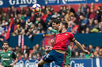 Aritz Aduriz of Athletic Club  competes for the ball with Oier Sanjurjo of Club Atletico Osasuna during the match of  La Liga between Club Atletico Osasuna and Athletic Club Bilbao at El Sadar Stadium  in Pamplona, Spain. April 01, 2017. (ALTERPHOTOS / Rodrigo Jimenez)