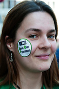 March 28th 2012. Demonstration organised by NUT (National Union of Teachers) to protest against changes to pensions and retirement age. Young woman with sticker on her face saying 'Save our Pensions'.