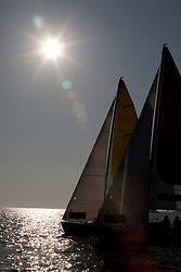 world match racing yachts sail off for semi finals places as the sun starts to set   the world match racing tour    ,in  Marseille,France 10 April 2010 Photo: Brendon O'Hagan/Subzero images