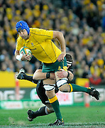 Nathan Sharpe on the charge for Wallabies, Rugby Championship. Australia v All Blacks at ANZ Stadium, Sydney, New Zealand. Saturday 18 August 2012. New Zealand. Photo: Richard Hood/photosport.co.nz