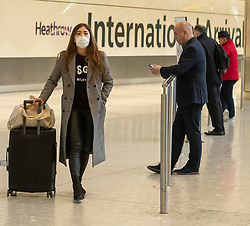 © Licensed to London News Pictures. 29/01/2020. London, UK. Passengers with protective masks at London Heathrow Terminal 5 as the last BA flight from China is expected to arrive this afternoon. The coronavirus virus has infected more than 40000 people across Asia in the past few weeks. Photo credit: Alex Lentati/LNP