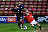 Liam Kinsella of Walsall battles for possession during the EFL Sky Bet League 2 match between Walsall and Tranmere Rovers at the Banks's Stadium, Walsall, England on 13 April 2021.