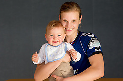 Barbara Varlec Lazovic of Krim with her son Luka after the last game of 1st A Slovenian Women Handball League season 2011/12 between ZRK Krka and RK Krim Mercator, on May 8, 2012 in Stopice at Novo mesto, Slovenia. RK Krim Mercator became Slovenian National Champion, GEN-I Zagorje placed second and ZRK Krka placed third. (Photo by Vid Ponikvar / Sportida.com)