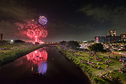 Fireworks display over Trinity River at July 4th celebration on the Trinity Trails near the Panther Island Pavilion, Trinity River, Fort Worth, Texas, USA. HDR image (two images combined).